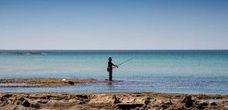 ensam fiskare Arkivbild