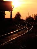 Ensambladura ferroviaria en la puesta del sol Imagen de archivo libre de regalías