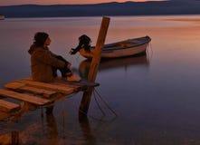 Ensamhet på solnedgången Arkivbild
