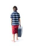 Ensamt barn med resväskan som bort går Royaltyfri Fotografi