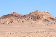 Ensamt landskap för pastellfärgade rosa färger för öken, Namibia Fotografering för Bildbyråer