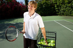 Enseñanza del instructor del tenis Imagenes de archivo