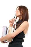 Enseñe el pensamiento de la muchacha, sosteniendo la pila de libros Fotografía de archivo