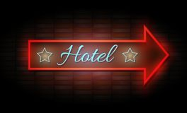 Enseigne au néon d'hôtel sur le mur de briques Photo libre de droits