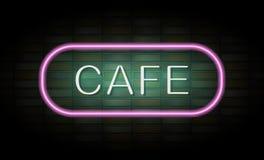 Enseigne au néon de café sur le mur de briques Photos libres de droits