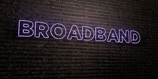 - Enseigne au néon réaliste sur le fond de mur de briques - 3D À BANDE LARGE a rendu l'image courante gratuite de redevance Photographie stock libre de droits