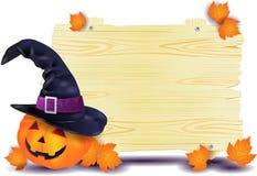 Enseigne de Halloween avec le grand chapeau du ` s de potiron et de sorcière Photographie stock libre de droits