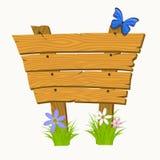 Enseigne en bois avec des fleurs et des papillons Image stock
