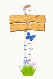 Enseigne en bois avec des fleurs et des papillons Images stock