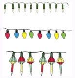 Ensemble électrique de vecteur de ficelles de lumière de Noël de variété tirée par la main Photographie stock libre de droits