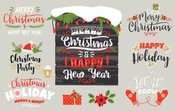 Ensemble conceptions de Noël et de bonne année de lettrage dans des couleurs traditionnelles Image stock