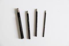 Ensemble creux de poinçon, quatre morceaux sur le fond blanc, outils pour mis Photographie stock