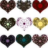 Ensemble d'éléments décoratifs en forme de coeur avec des ornements Photographie stock libre de droits