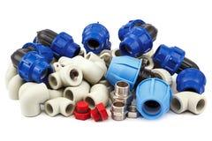 Ensemble d'accouplements de tuyauterie de métal-plastique, adaptateurs, prises photos libres de droits