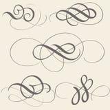 Ensemble d'art de flourish de calligraphie avec les spirales décoratives de vintage pour la conception sur le fond beige Illustra Photo libre de droits