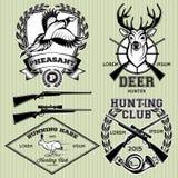 Ensemble d'emblèmes avec un cerf commun, lièvres, faisan pour la chasse Images libres de droits