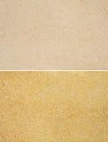 Ensemble d'or et de fond de sables de beige Photographie stock libre de droits