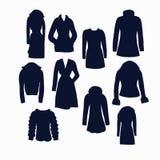 Ensemble d'icônes des vêtements d'hiver de femmes Photographie stock libre de droits