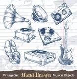 Ensemble d'objets musicaux tirés par la main Photographie stock libre de droits