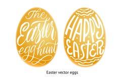 Ensemble d'oeufs d'or Joyeuses Pâques et Pâques chassent le lettrage dans par exemple Photos libres de droits
