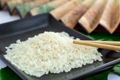 Ensemble d'Oriental de riz, de baguettes et de transp Images stock