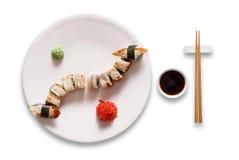 Ensemble d'unagi et de petits pains de sushi au blanc Images stock