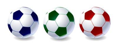 Ensemble de ballons de football de différentes couleurs Photos stock