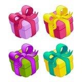 Ensemble de boîtes-cadeau colorées avec des proues et des bandes Photographie stock libre de droits