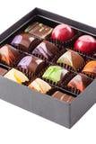 Ensemble de bonbons au chocolat dans une boîte Images stock