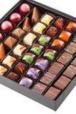 Ensemble de bonbons au chocolat dans une boîte Photo stock
