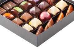 Ensemble de bonbons au chocolat dans une boîte Photographie stock libre de droits