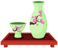 Ensemble de bouteille de saké avec la petite tasse Image stock