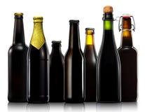 Ensemble de bouteilles à bière d'isolement sur le fond blanc Image libre de droits