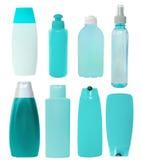 Ensemble de bouteilles cosmétiques bleues d'isolement Images libres de droits