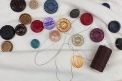 Ensemble de boutons et de bobine colorés d'amorçage Images libres de droits