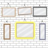 Ensemble de cadres de tableau sur le calibre de mur de briques Photographie stock libre de droits