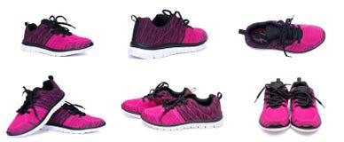 Ensemble de chaussures roses et noires de femme de sport d'isolement sur le fond blanc Photo stock