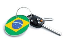 Ensemble de clés de voiture avec le drapeau de porte-clés et de pays Concept pour la voiture p Images stock
