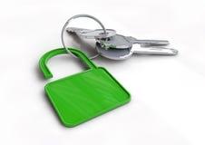 Ensemble de clés de voiture avec le porte-clés de l'icône verte de serrure Images stock
