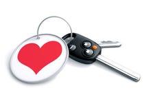 Ensemble de clés de voiture avec le porte-clés et l'icône rouge de coeur Concept pour la façon dont Image libre de droits