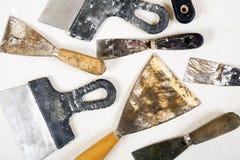 Ensemble de couteaux de mastic sur le fond blanc Photo stock