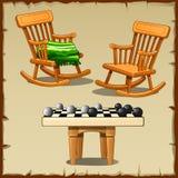 Ensemble de deux chaises de basculage avec des contrôleurs sur en bois Images stock