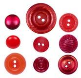 Ensemble de différents, nouveaux et vieux boutons rouges sur un fond blanc Image stock