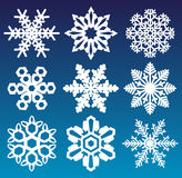 Ensemble de flocons de neige de vecteur d'isolement sur le fond bleu Illustration Stock