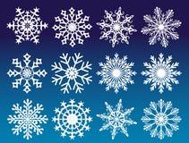 Ensemble de flocons de neige de vecteur sur le fond bleu Illustration Stock