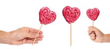 ensemble de forme fabriquée à la main différente de coeur de sucrerie avec la main, d'isolement sur le fond blanc Photographie stock