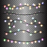 Ensemble de guirlandes colorées légères chaudes de lampes, décorations de fête Lumières de Noël rougeoyantes sur transparent Photo libre de droits