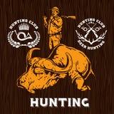 Ensemble de labels de chasse sur le bakground en bois Images stock