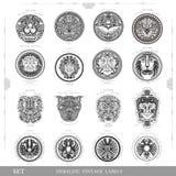 Ensemble de labels royaux de vintage de couleur avec le visage d'aigle et d'homme de lion Photographie stock