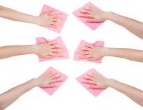 Ensemble de mains avec des chiffons roses de tissu d'isolement Image libre de droits